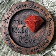 Gallery pic of the Ruby Cave plaque by Embry McKee, maker of family crests, coats of arms, university crests, corporate and sports logos, and other carved designs in hard woods