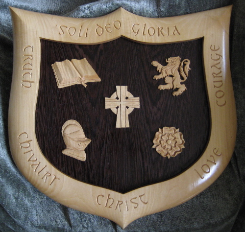 Graduation Crest, by Embry McKee of Legacy Crests, maker of custom handmade and hand carved wooden school, family, and corporate crests, shields, coats of arms, logos, and signs from exotic hardwoods.