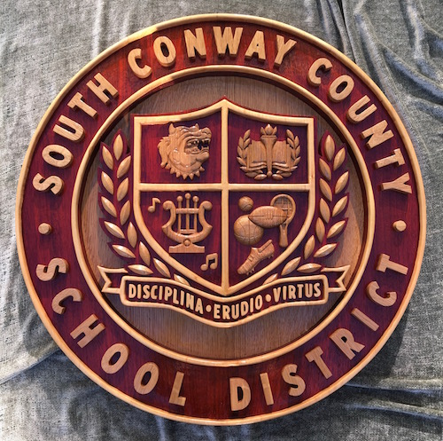 South Conway County District Crest page of Legacy Crests by Embry McKee, creator of hardwood designs of family crests, corporate logos, college and university logos, sports insignia, heraldry, etc.