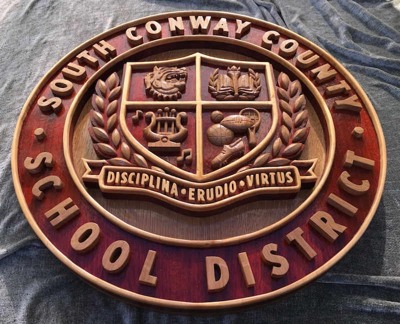 South Conway County District Crest, by Embry McKee of Legacy Crests, makers of custom handmade wood school, family, and corporate crests, logos, devices, and signs from exotic hardwoods, any size or design, to your specification.
