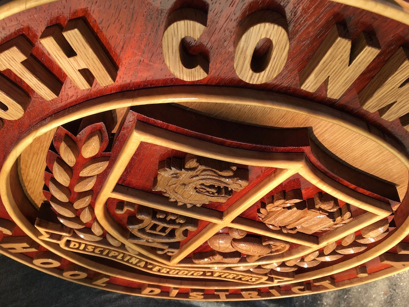 South Conway County District Crest, by Embry McKee of Legacy Crests, maker of custom handmade wood school, family, and corporate crests, logos, devices, and signs from exotic hardwoods, any size or design, to your specification.
